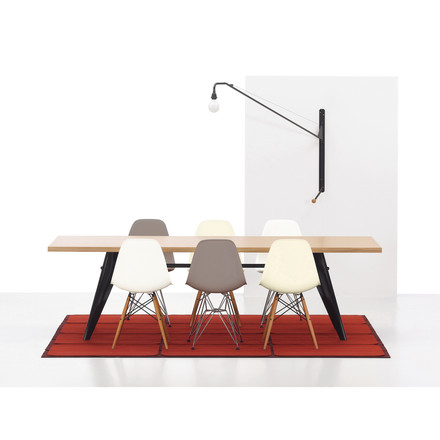 Em Table, a dining table by Vitra, oak in natural/black with Potence lamp