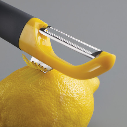 Multi-peel with serrated blade and zest cutter