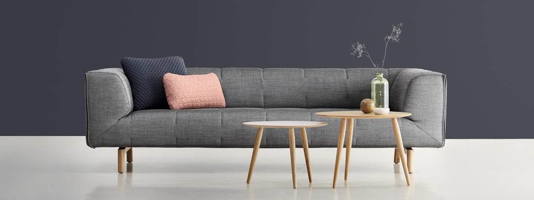 Design from denmark: Sofa and Playround Side Table from bruunmunch in the shop. A comfortable, grey upholstered sofa which invites you to take a seat.
