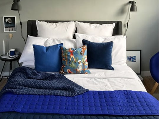 Blue room design with the Baby Dot Quilt by HAY. Blogger BritDecor uses different textures and tones to create depth and energy.